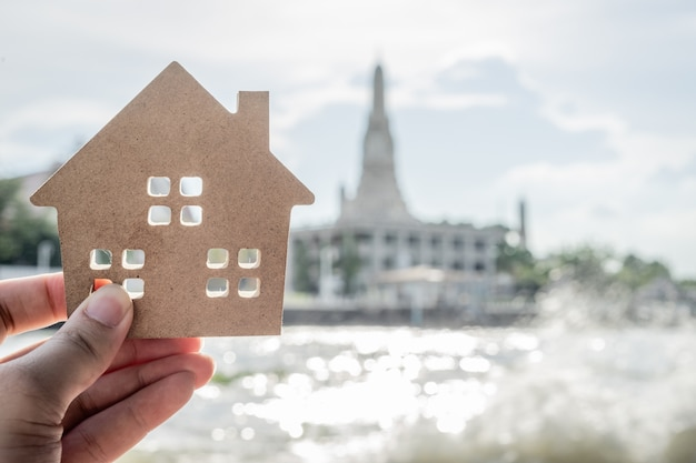 House model in home insurance broker agent 's hand or in salesman person.
