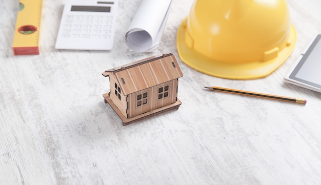House model with tools on white background