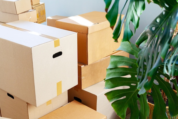 House moving concept with stacked cardboard boxes in a room