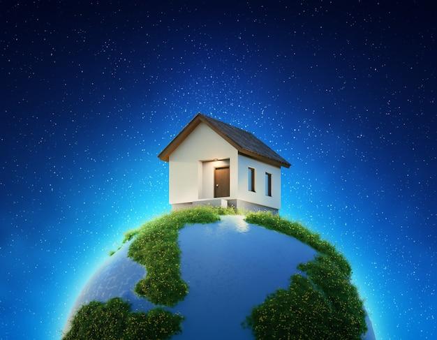 부동산 판매 또는 부동산 투자 개념에서 지구와 푸른 잔디에 집