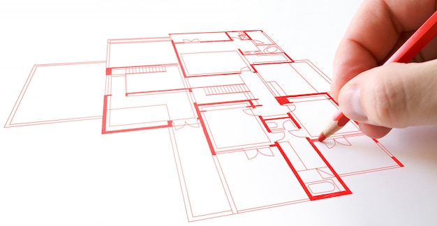 House plan drawing with red pencil on paper