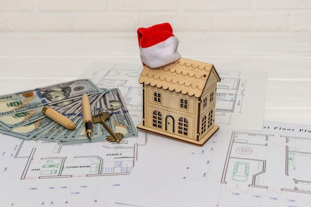 House plan with house model, dollars and key