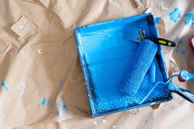House renovation tools, paint roller in blue color