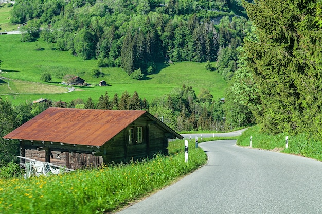 House next to the road  in the le sepey region of swiss alps, switzerland