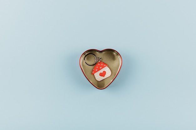 House shaped keychain with red heart