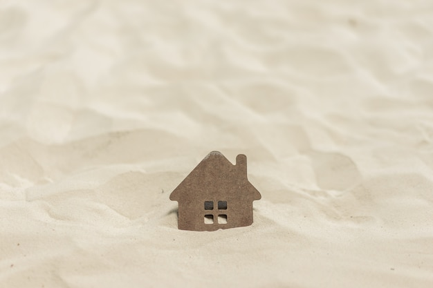 House sinking in sand
