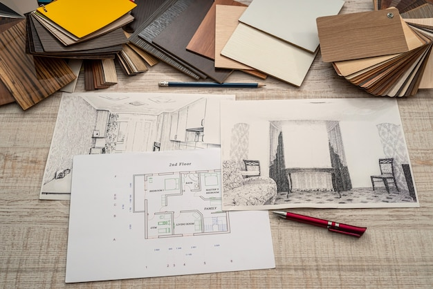 House sketch layout with color swatches palette at office desk, planning concept