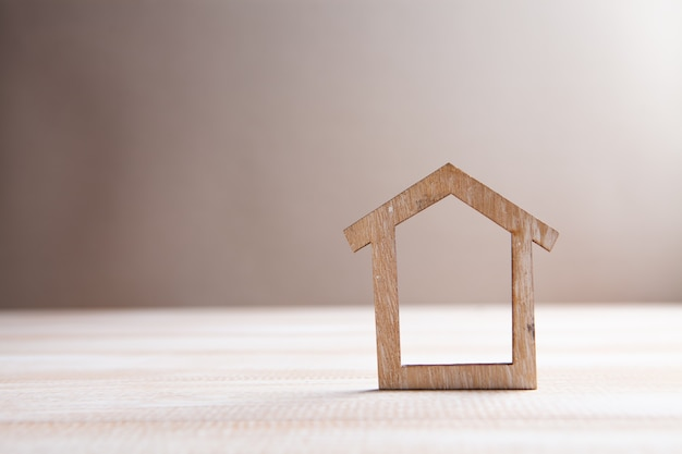 House on table on brown background