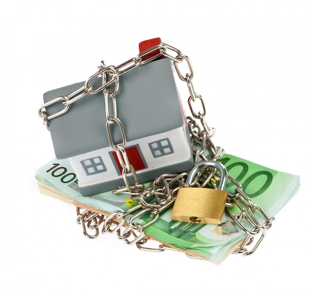 House with bills, chain and padlock