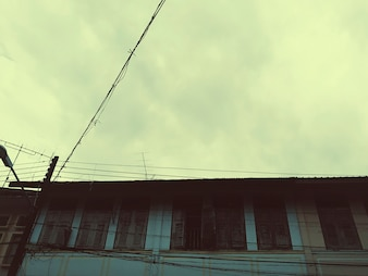 House with cloudy sky