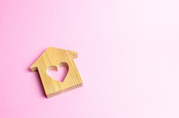 House with a heart on a pink background