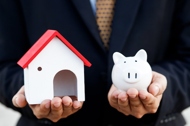 House with piggy bank, low-income home loan bank