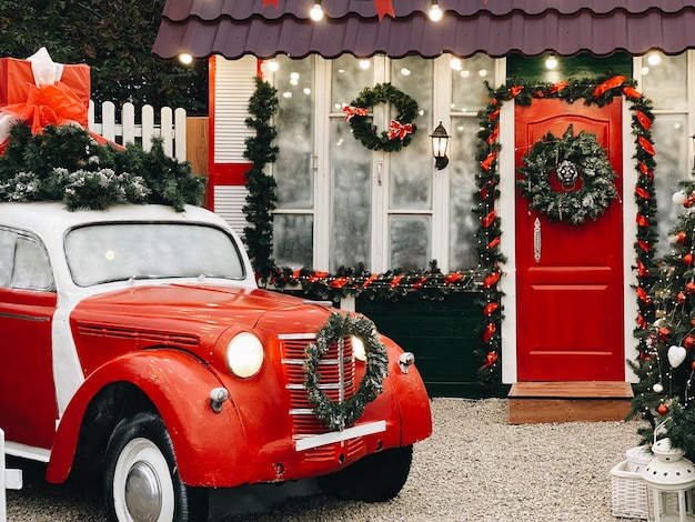 House with retro car in christmas decorations