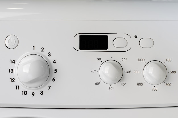 Household appliances concept. a part of washing machine control panel.