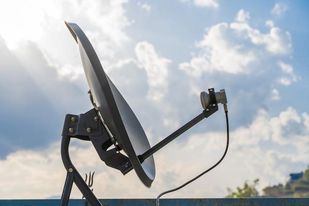 Household parabolic sattelite dish antenna for tv channels and internet, stock photo