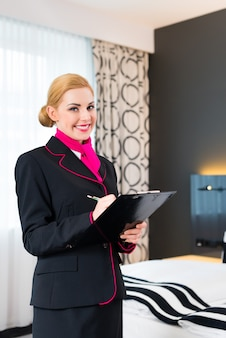 Housekeeper checking hotel room
