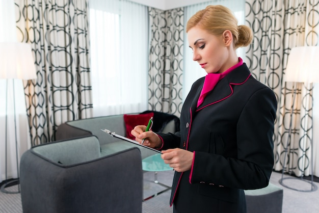 Housekeeper checking hotel suite