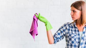 Housekeeper holding a rag