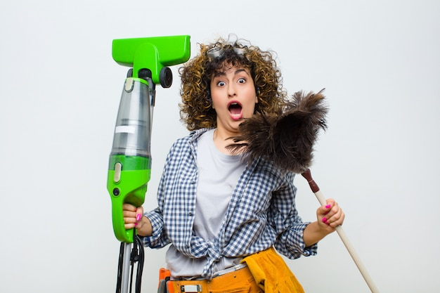 Housekeeper pretty woman with a vaccum cleaner