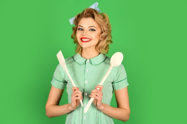 Housekeeper with kitchen utensil