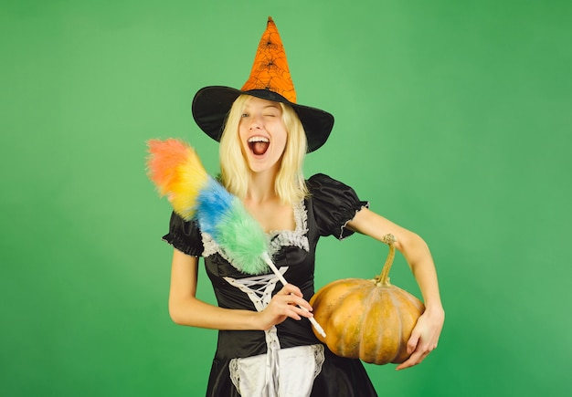 Housekeeper with pumpkin and knife. costumes housekeeper and halloween hats.