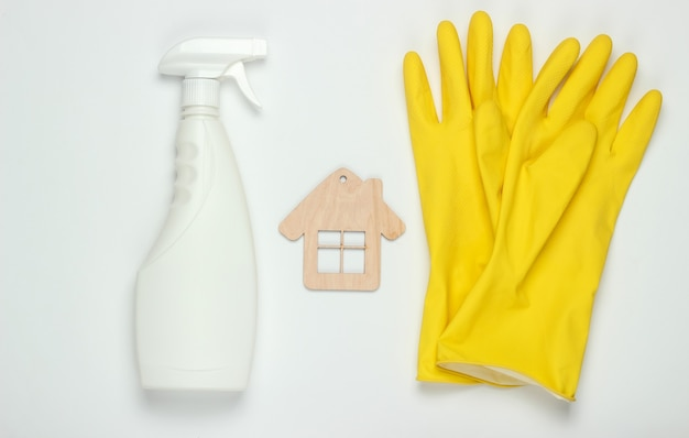 Housekeeping concept. set of products for cleaning (gloves, spray bottle) and house figure on white background. top view.