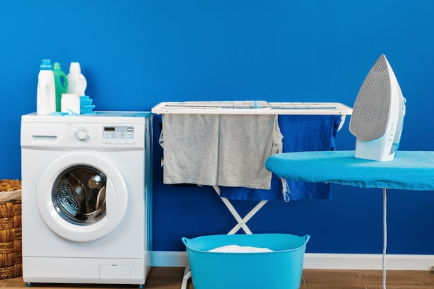Housekeeping concept. washing machine and ironing board