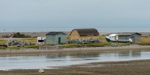 Houses along the coast, parson's pond, gros morne national park, newfoundland and labrador, canada