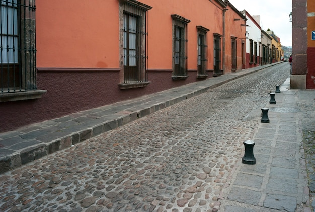 Houses along a cobblestone street, san miguel de allende, guanajuato, mexico