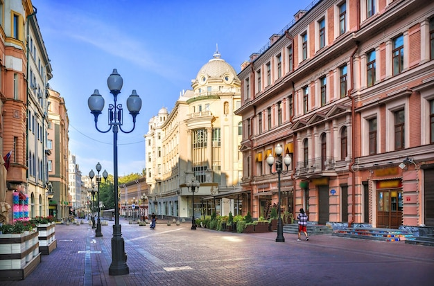 Houses and cafes on the arbat in moscow on a summer morning
