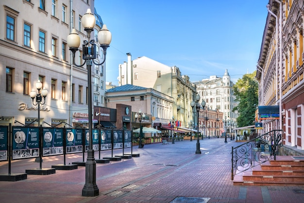 Houses and cafes and lanterns on the arbat in moscow on a summer morning