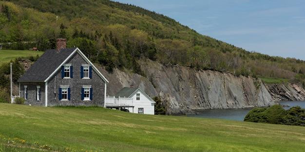 Houses at coast, meat cove, cape north, cape breton island, nova scotia, canada