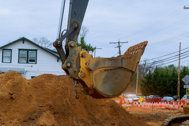 Houses under construction foundation with excavator