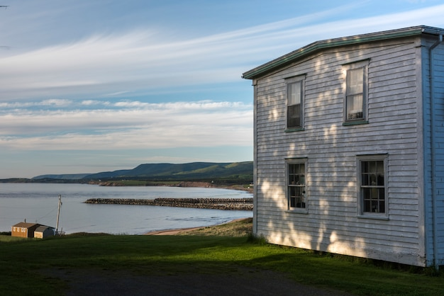 Houses at waterfront, margaree river, margaree harbour, cabot trail, cape breton island, nova scotia