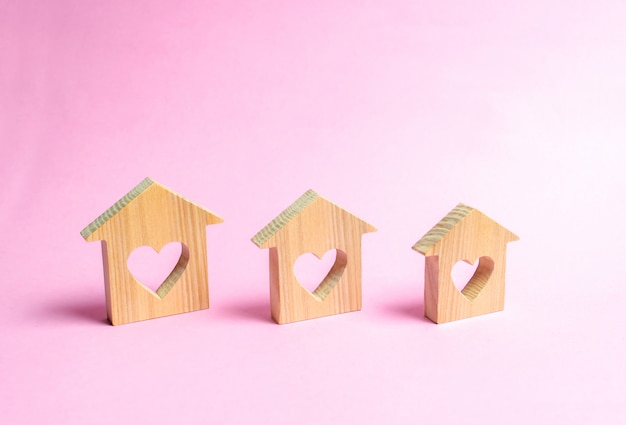 Houses with hearts inside on a pink background