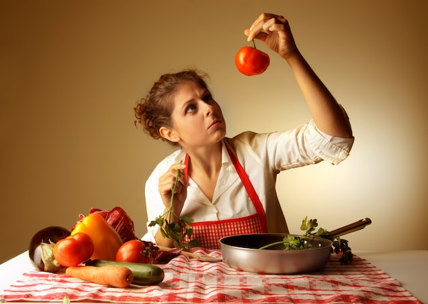 Housewife checking vegetables for recipe