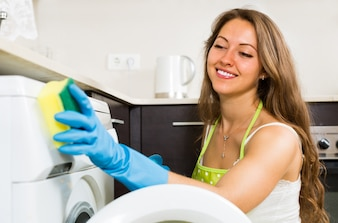 Housewife cleaning washing machine