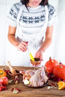 Housewife prepares roast chicken