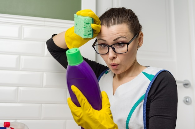 Housewife woman does the cleaning