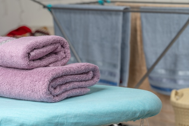 Housework concept. ironing towels on ironing board