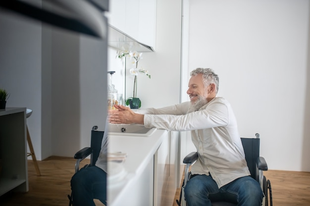Housework. mature handicapped man at home doing some housework