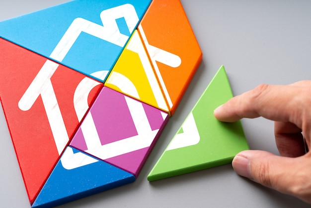 Housing estate and home concept icon on colorful puzzle