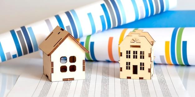 차트 표면에 그래프와 함께 주택 시장 컨셉 이미지