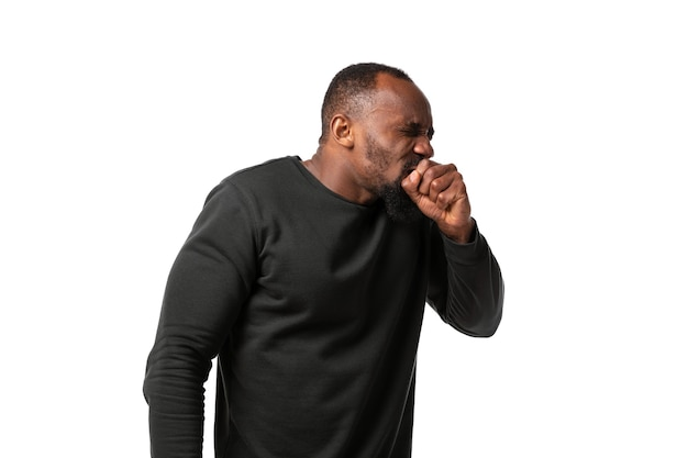 How coronavirus changed our lives young man coughing on white wall
