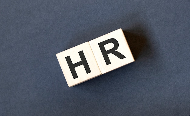 Hr, human resources and recruitment concept by cube wooden block with alphabet building the word