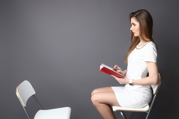 Hr interviewing an empty office chair, side view