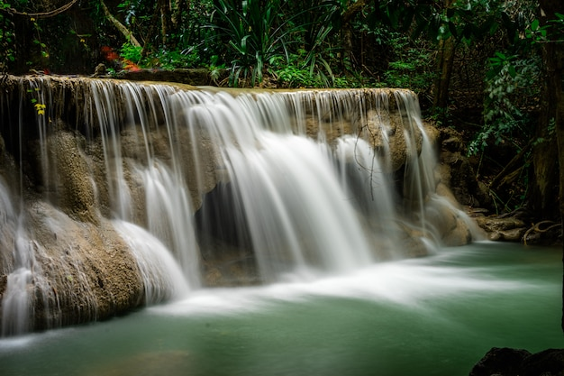 Huai mae khamin waterfall at deep tropical rainforest in srinakarin dam, national park in thailand