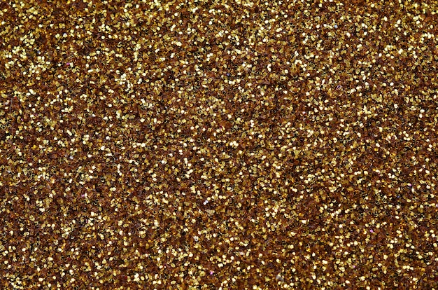 A huge amount of yellow decorative sequins. background