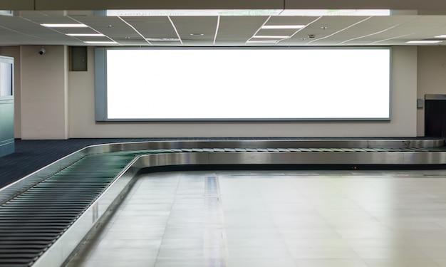 Huge blank billboard in the airport. Premium Photo
