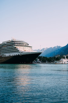 Huge cruise ship in the bay of kotor in montenegro. near the old town of kotor. a beautiful country to travel.